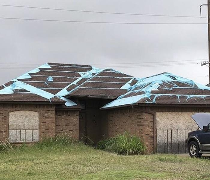 Strong winds and rain roof damage
