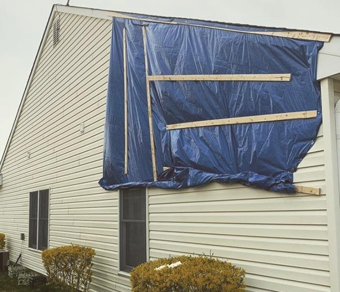 Tarp on wall